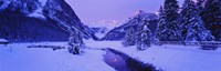 Lake in winter with mountains in the background, Lake Louise, Banff National Park, Alberta, Canada Fine Art Print