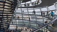 Tourists near the mirrored cone at the center of the dome, Reichstag Dome, The Reichstag, Berlin, Germany Fine Art Print