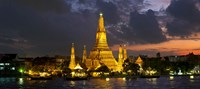 Buddhist temple lit up at dawn, Wat Arun, Chao Phraya River, Bangkok, Thailand Fine Art Print
