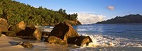 Waves splashing onto rocks on North Island with Silhouette Island in the background, Seychelles Fine Art Print