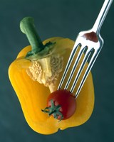 Close up of half yellow pepper with cherry tomato in center on fork tines Fine Art Print