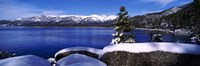 Lake with a snowcapped mountain range in the background, Sand Harbor, Lake Tahoe, California, USA Framed Print
