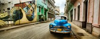 Old car and a mural on a street, Havana, Cuba Framed Print