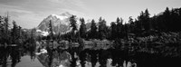 Reflection of trees and mountains in a lake, Mount Shuksan, North Cascades National Park, Washington State (black and white) Framed Print