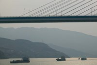 Container ships passing a newly constructed bridge on the Yangtze River, Wanzhou, Chongqing Province, China Fine Art Print