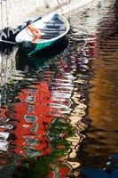 Houses and boat reflected in Lake Como, Varenna, Lombardy, Italy Fine Art Print