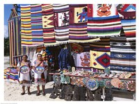 Two female vendors dressed in Mayan costumes displaying products Framed Print