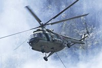A Bulgarian Air Force Mi-17 helicopter over a forest fire in Bulgaria Fine Art Print