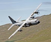 A C-130J Super Hercules low flying over North Wales on a training flight Fine Art Print