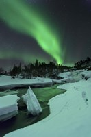 Aurora Borealis over a frozen Tennevik River, Troms, Norway Fine Art Print