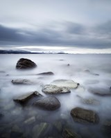Long exposure scene of rocks in Vaagsfjorden fjord, Norway Fine Art Print