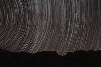 Star trails above a valley in the Firoozkooh area, Iran Fine Art Print