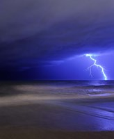 A bolt of lightning from an approaching storm in Miramar, Argentina Fine Art Print