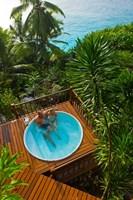 Couple enjoying hot tub at Fregate Resort, Seychelles Fine Art Print