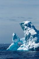 An arched iceberg floating in Gerlache Strait, Antarctica. Fine Art Print
