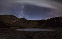 Star trails and the blurred band of the Milky Way above a lake in the Eastern Sierra Nevada Fine Art Print