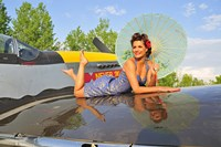 1940's style pin-up girl with parasol on a vintage P-51 Mustang Fine Art Print