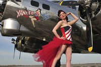 Beautiful 1940's style pin-up girl standing under a B-17 bomber Fine Art Print