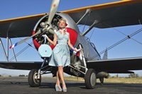 Elegant 1940's style pin-up girl standing in front of an F3F biplane Fine Art Print