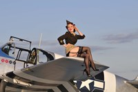 Pin-up girl sitting on the wing of a P-51 Mustang Fine Art Print