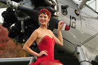 Redhead pin-up girl in 1940's style dancer attire holding on to a vintage aircraft propeller Fine Art Print