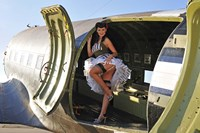 Sexy 1940's style pin-up girl standing inside of a C-47 Skytrain aircraft Fine Art Print
