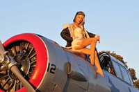 1940's style aviator pin-up girl posing with a vintage T-6 Texan aircraft Fine Art Print