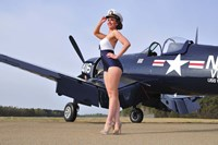 1940's Navy pin-up girl posing with a vintage Corsair aircraft Fine Art Print