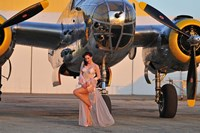 Sexy 1940's pin-up girl in lingerie posing with a B-25 bomber Fine Art Print