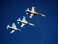 Two F-5 Tiger II's and an A-4E Skyhawk in flight above the Pacific Ocean Fine Art Print
