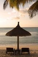 Mauritius, Beach scene, umbrella, chairs, palm fronds Fine Art Print