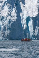 Zodiac with iceberg in the ocean, Antarctica Fine Art Print