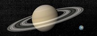 Large planet Saturn and its rings next to small planet Earth Fine Art Print