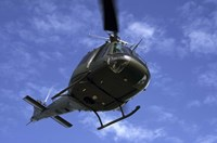 Former US Air Force Bell UH-1E Huey helicopter in flight Fine Art Print