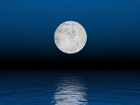Beautiful full moon against a deep blue sky over the ocean Fine Art Print