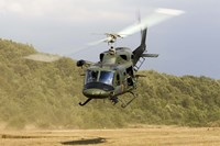 An Italian Air Force AB-212 ICO helicopter departs the landing zone, Italy Fine Art Print