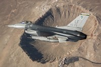 F-16C Fighting Falcon flying above Arizona's Meteor Crater Fine Art Print