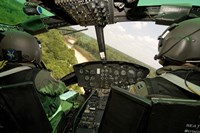 Two instructor pilots practice low flying operations in a UH-1H Huey helicopter Fine Art Print