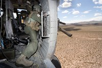 A HH-60G Pave Hawk gunner fires his GAU-17 machine gun Fine Art Print