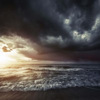 Bright sunset against a wavy sea with stormy clouds, Hersonissos, Crete Fine Art Print