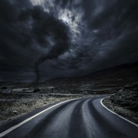 Tornado near a winding road in the mountains, Crete, Greece Fine Art Print