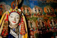 Religious statue infront of Buddha mural at Shey Palace, Ladakh, India Fine Art Print