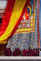 Monks raising a thangka during the Hemis Festival, Ledakh, India Fine Art Print