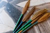 India, Jammu and Kashmir, Ladakh, Leh, brooms in a Buddhist temple Fine Art Print