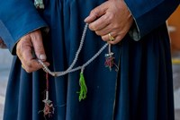 Woman's hands holding prayer beads, Ladakh, India Fine Art Print