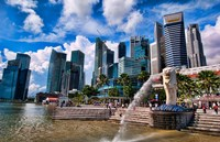 Merlion, symbol of Singapore, and downtown skyline in Fullerton area of Clarke Quay. Fine Art Print