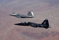 F-22 Raptor and T-38 Talon Fly in Formation over New Mexico Fine Art Print
