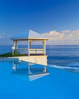 Gazebo reflecting on pool with sea in background, Long Island, Bahamas Fine Art Print