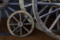 Rustic wagon wheels on movie set, Cuba Fine Art Print