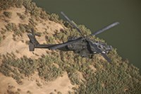 An AH-64D Apache Helicopter in Flight Fine Art Print